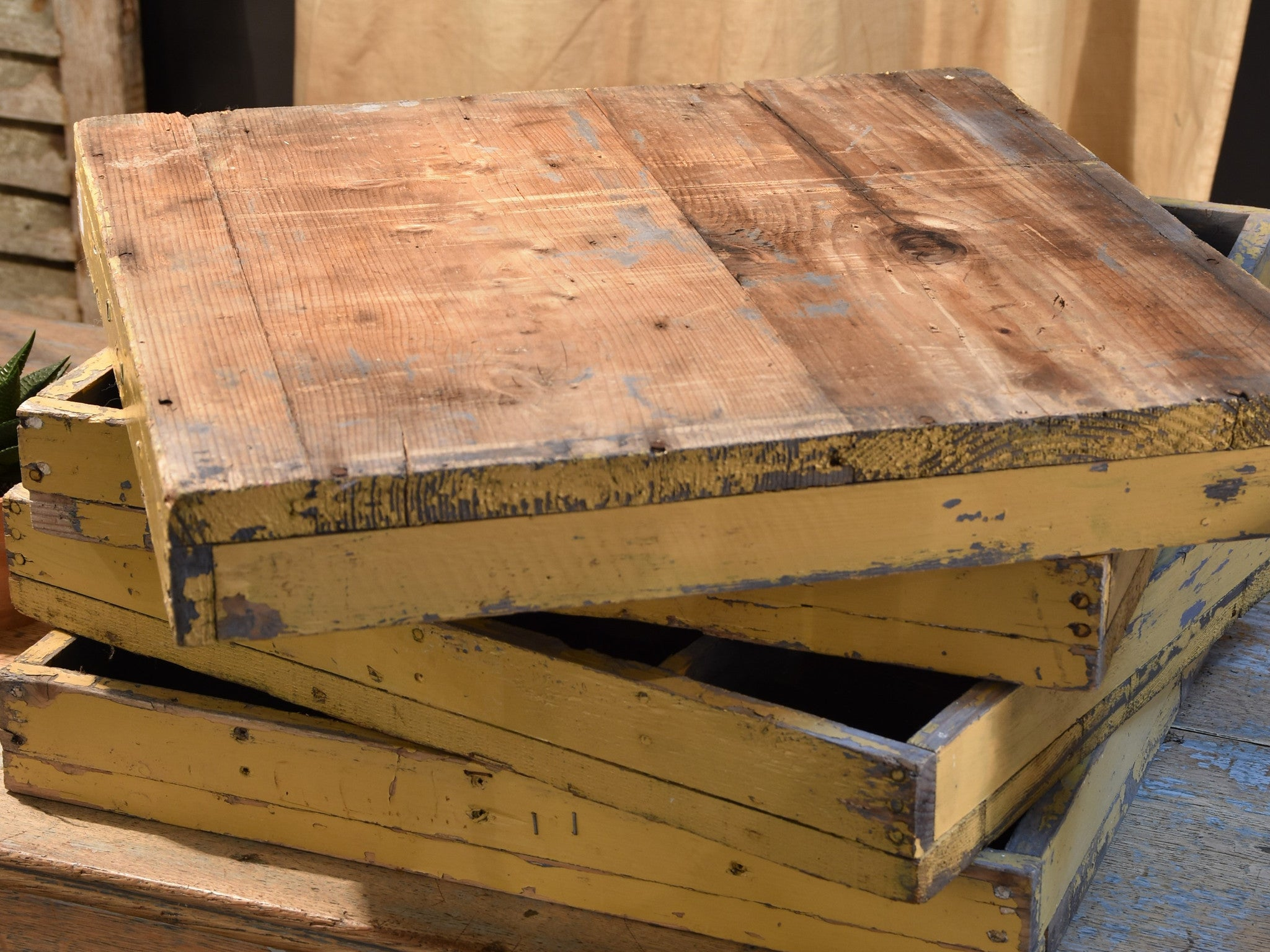 Four wooden French farm boxes
