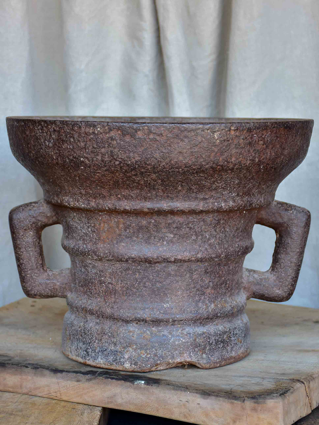 Antique iron mortar with bracket arms - European