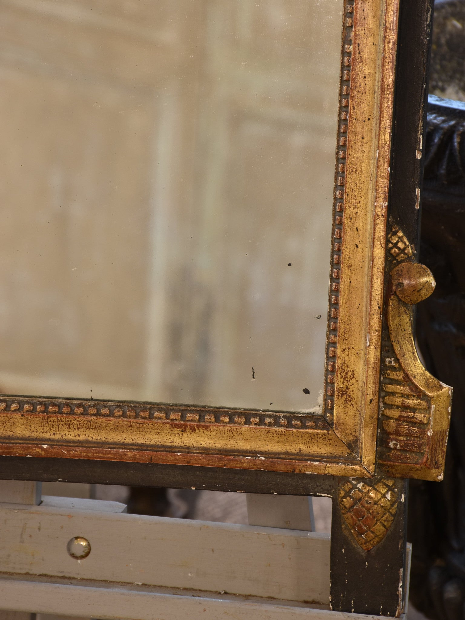 Antique Louis XVI style mirror with black & gilt wood frame