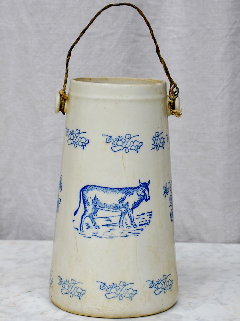 Antique French milk pitcher with cow and flowers