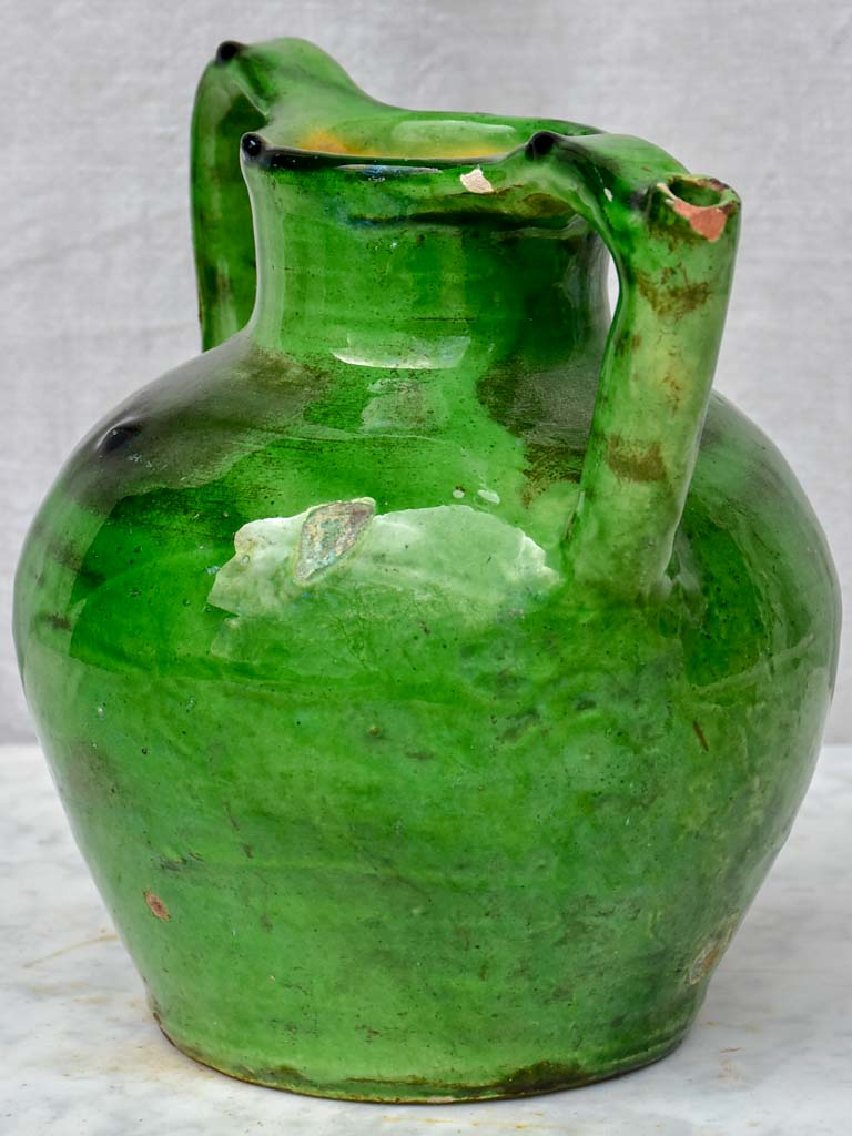 Antique French water jug with green glaze and spout