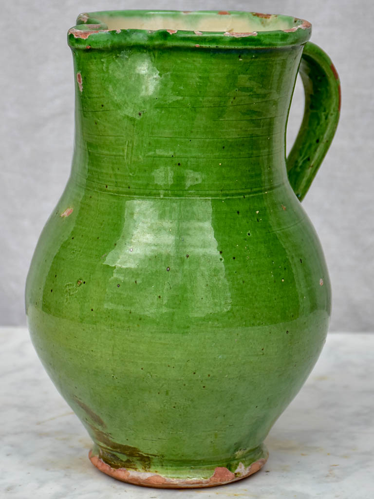 Antique French pitcher with green glaze