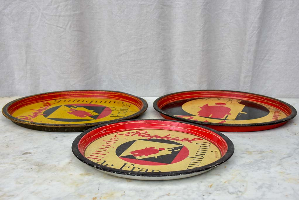 Collection of four round bistro trays - Quinquina