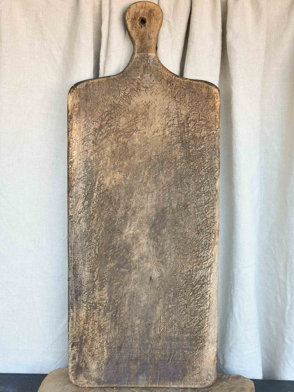 Very large antique French cutting board - puzzle piece silhouette  29 ½''