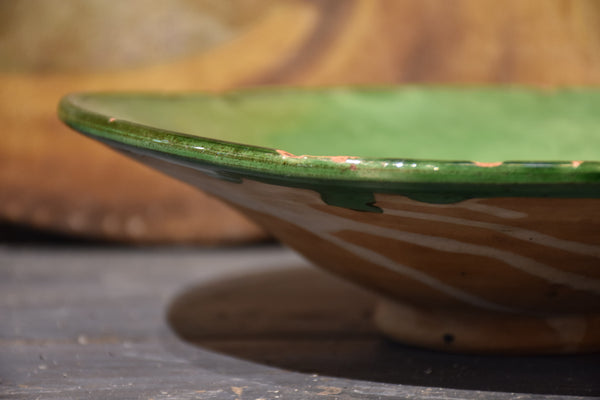 Antique French ceramic bowl (vire-omelette) with green glaze