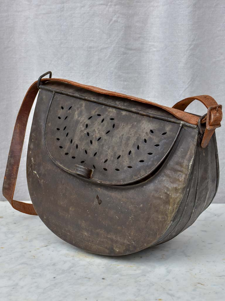 Antique French metal fishing bag with leather strap
