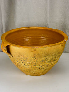 Very large antique Spanish bowl with orange glaze