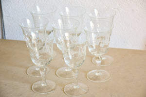 Set of eight vintage red wine glasses with decorative etchings