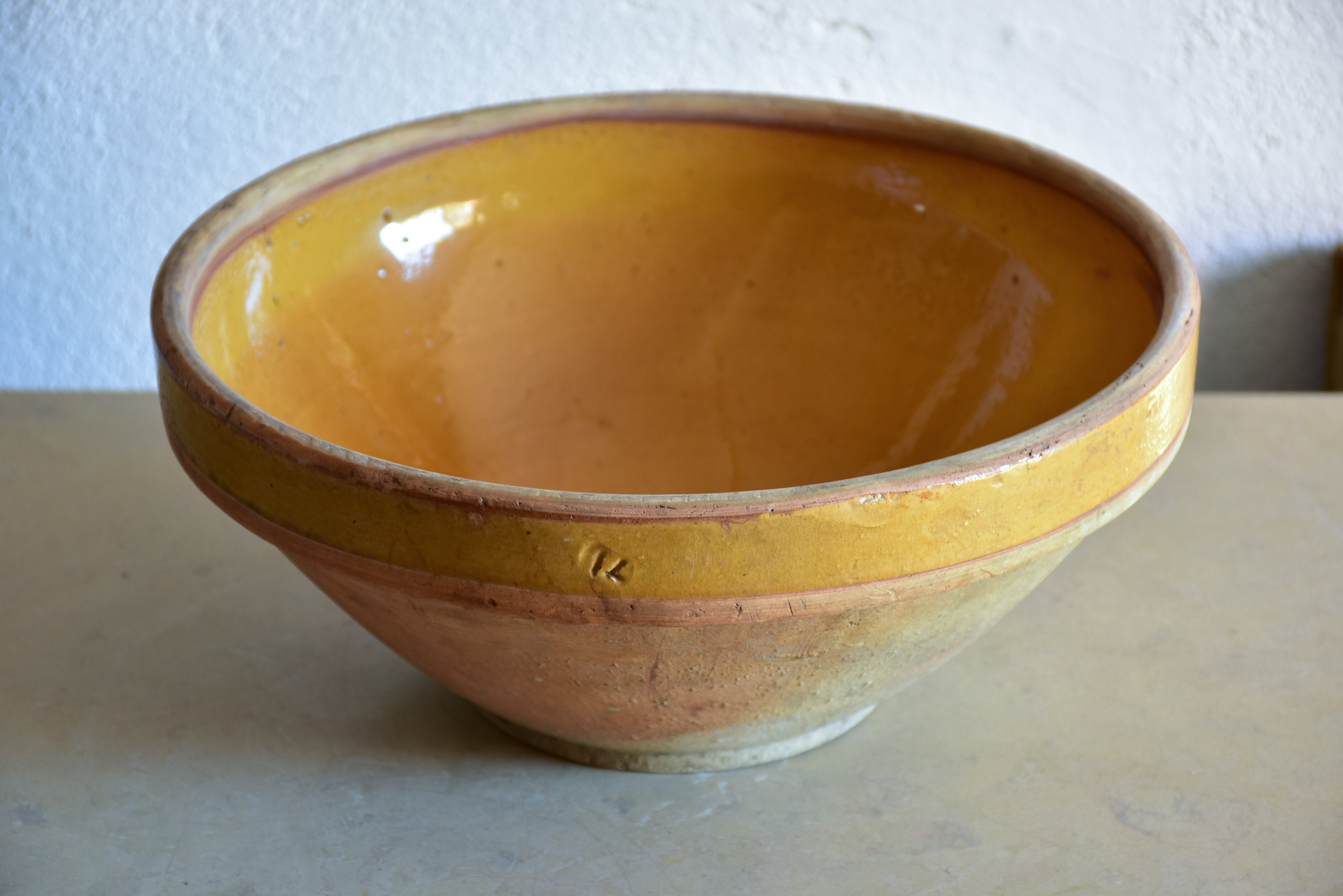 19th century kitchen bowl with ochre glaze