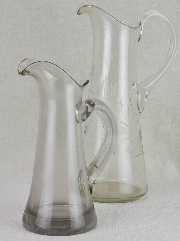 Two blown glass bistro cider pitchers