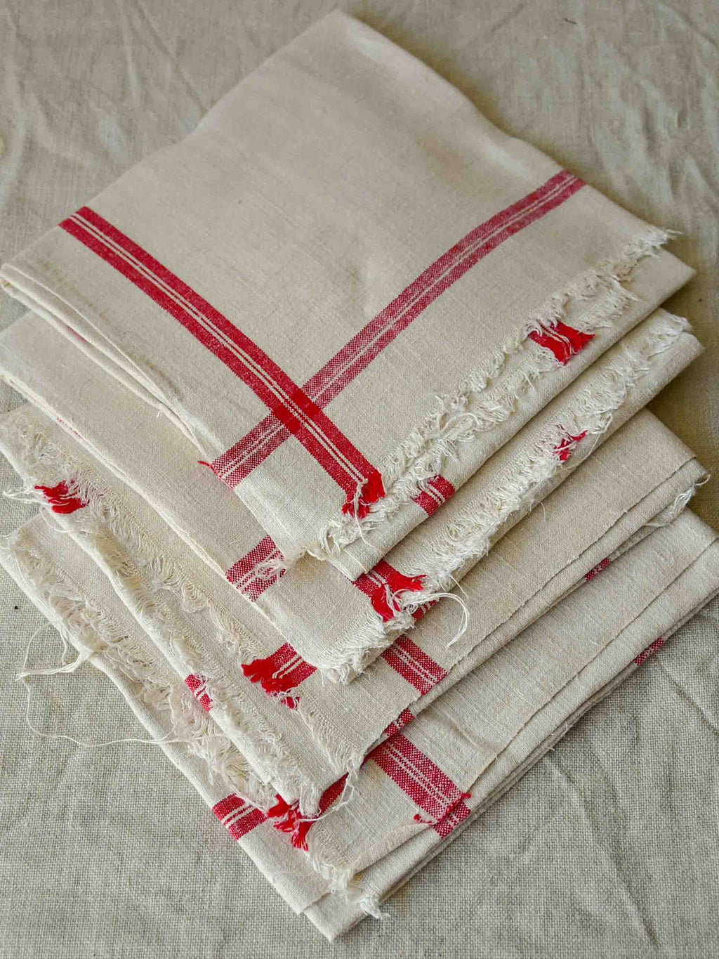 Four antique French tea towels / serviettes with red stripes