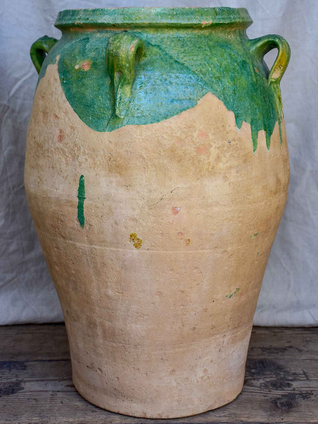 Antique French amphora pot with green glaze and four handles