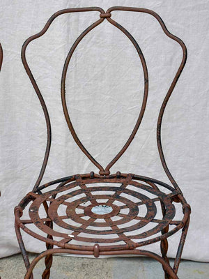 Pair of pretty black antique French garden chairs branded Vachon