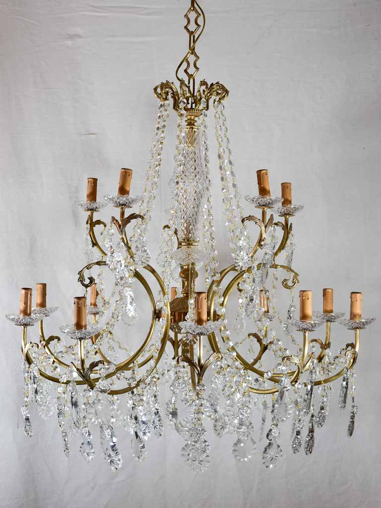 "Pair of large crystal and brass chandeliers with 15 lights from the 1940's 35½"" diameter"