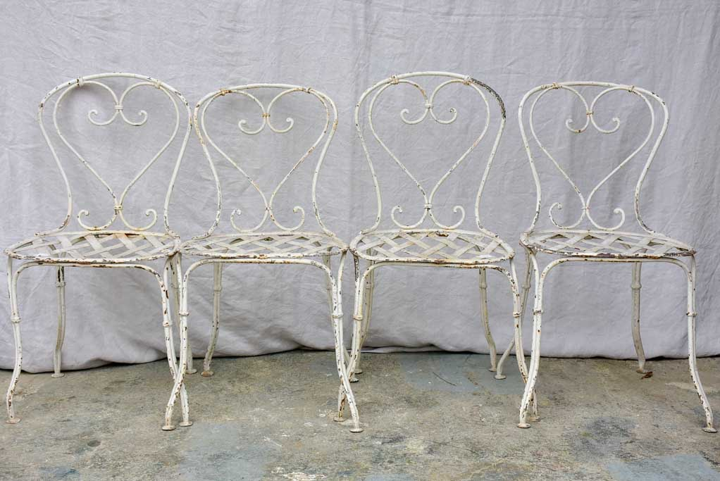 Four antique French garden chairs with heart back and lattice seat