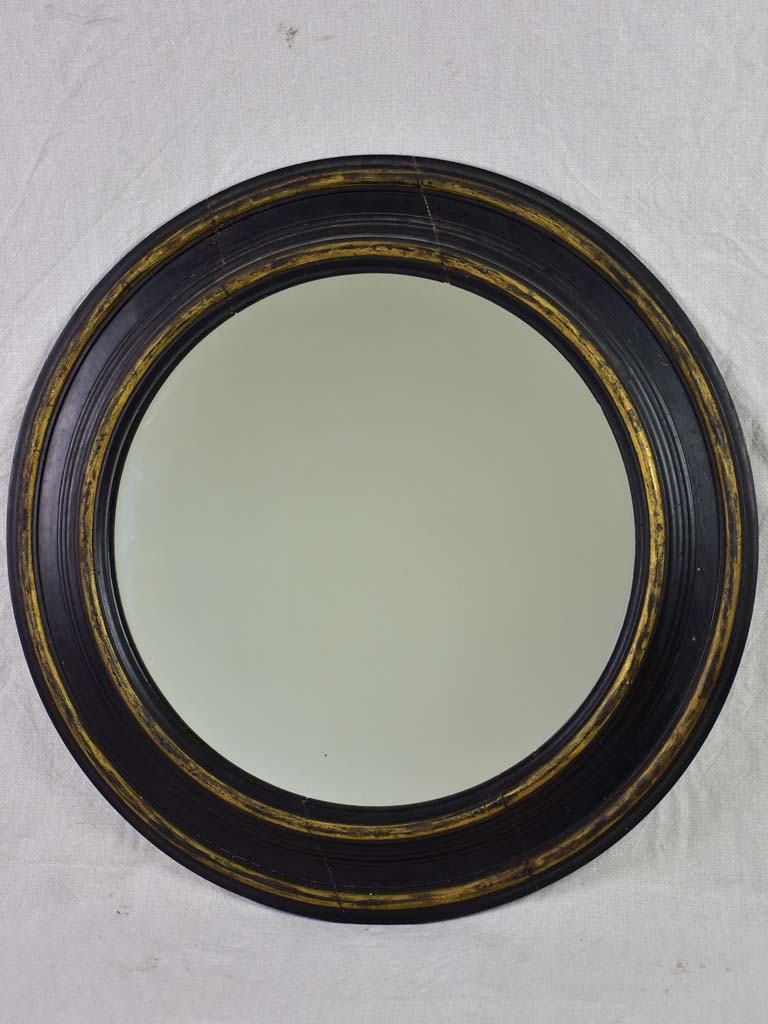 19th Century Napoleon III round mirror with black painted frame 27½""