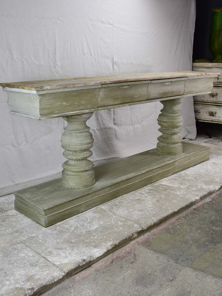 Narrow French console table with large turned column supports 78¾""