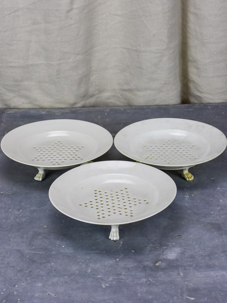 Set of three Directoire fruit strainer plates with claw feet