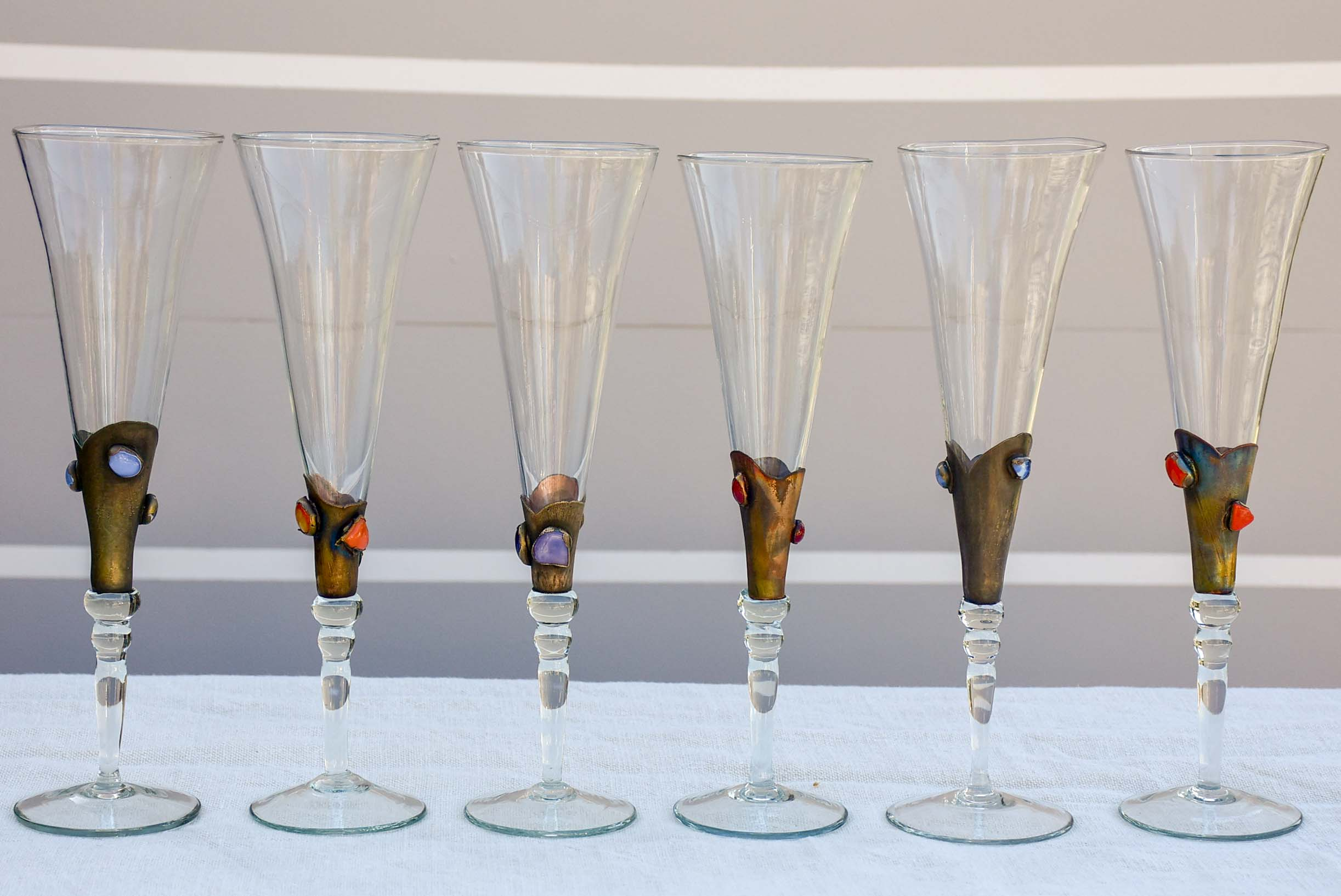 Set of twelve 1950's Murano glass champagne glasses with gemstones