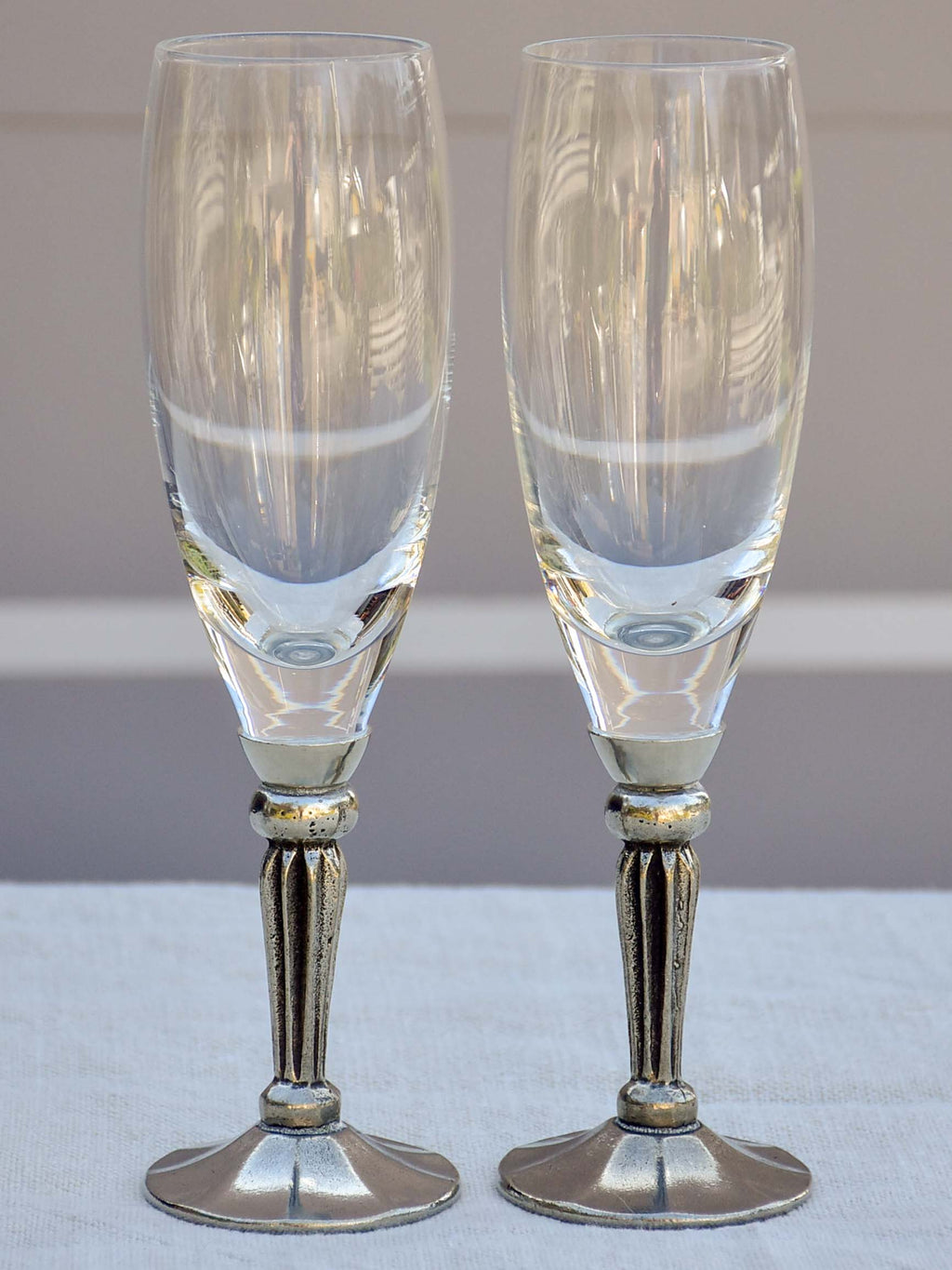 Six French mid-century crystal champagne flutes with pewter detail - signed