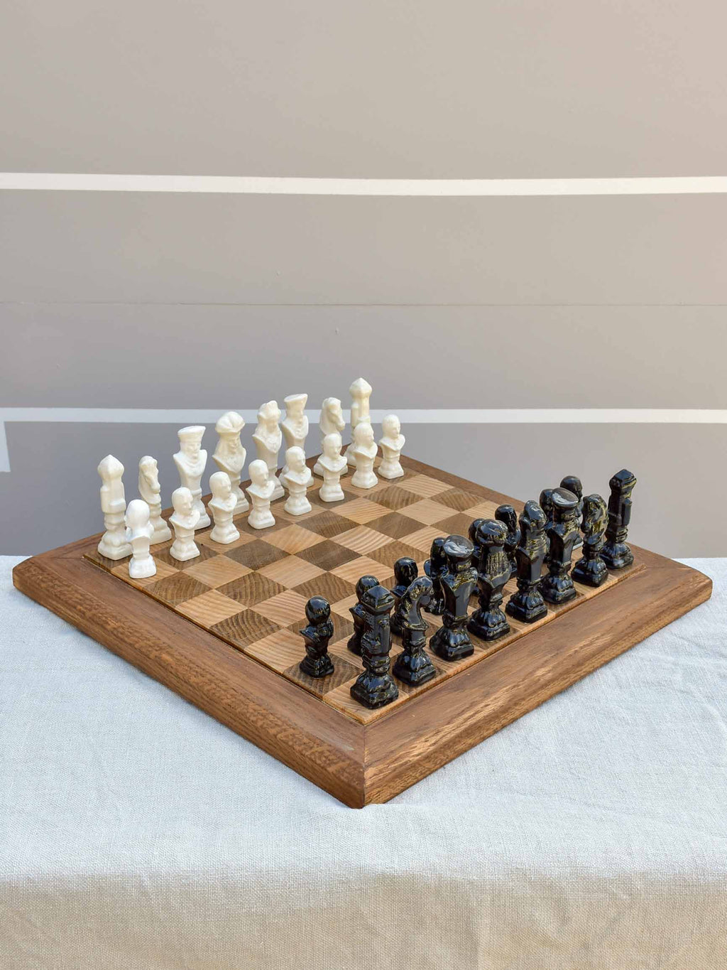 Vintage wooden chess board with porcelain pieces