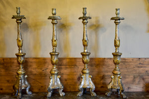 Four large antique Italian church candlesticks