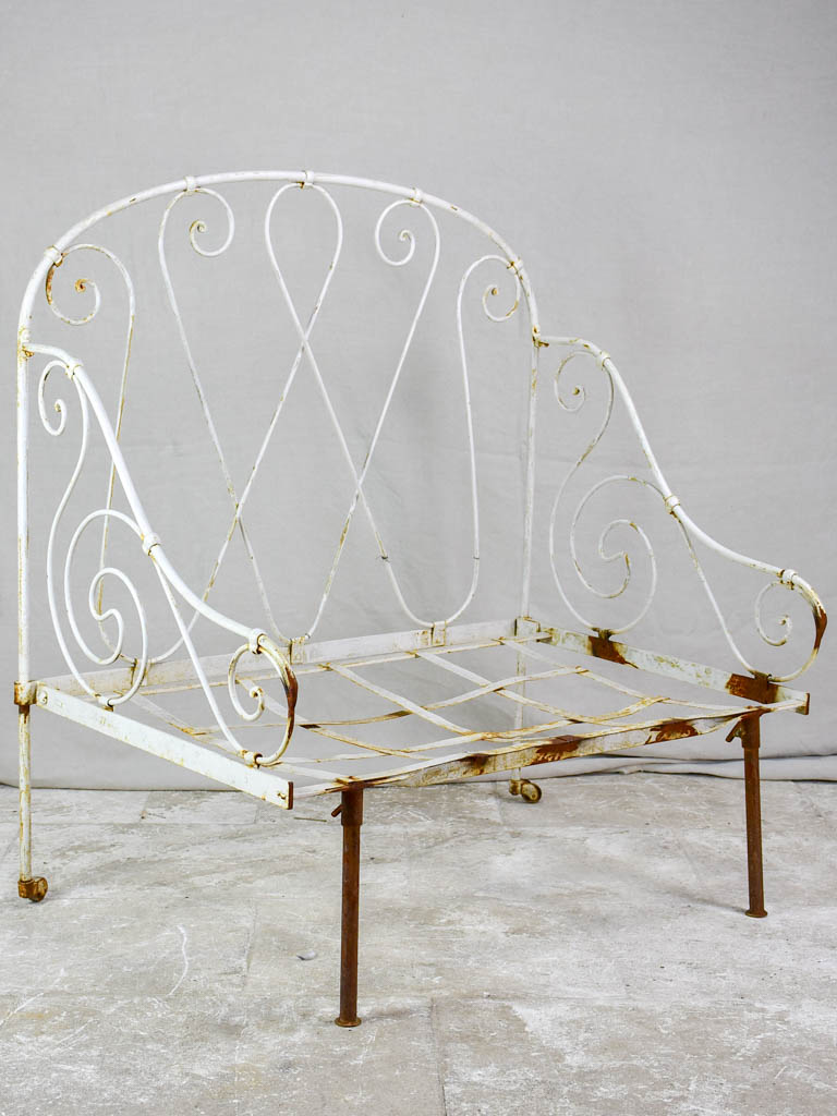 Antique French wrought iron folding armchair bed