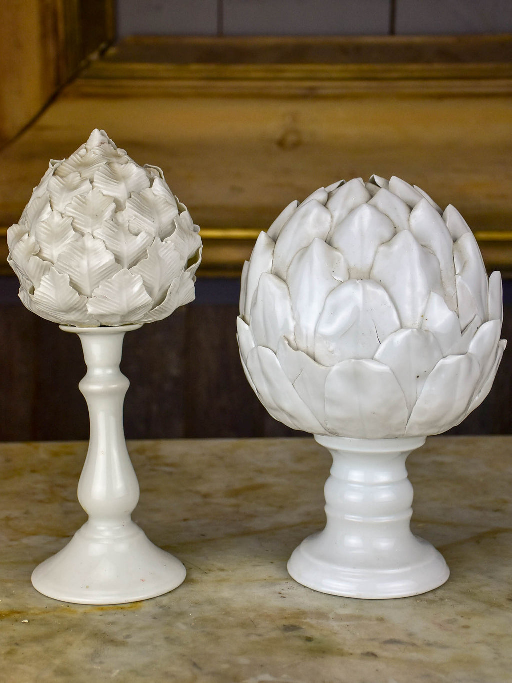Two antique earthenware mounted artichoke sculptures
