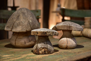 Three wooden French sculptures in the shape of mushrooms