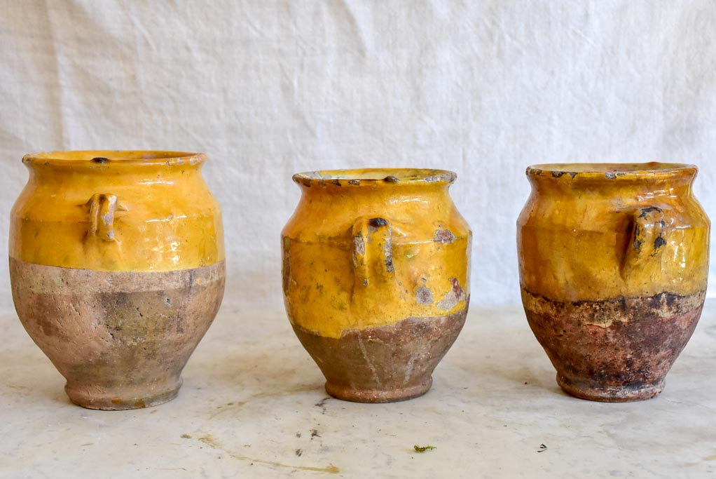 Collection of three very small antique French confit pots with ochre glaze