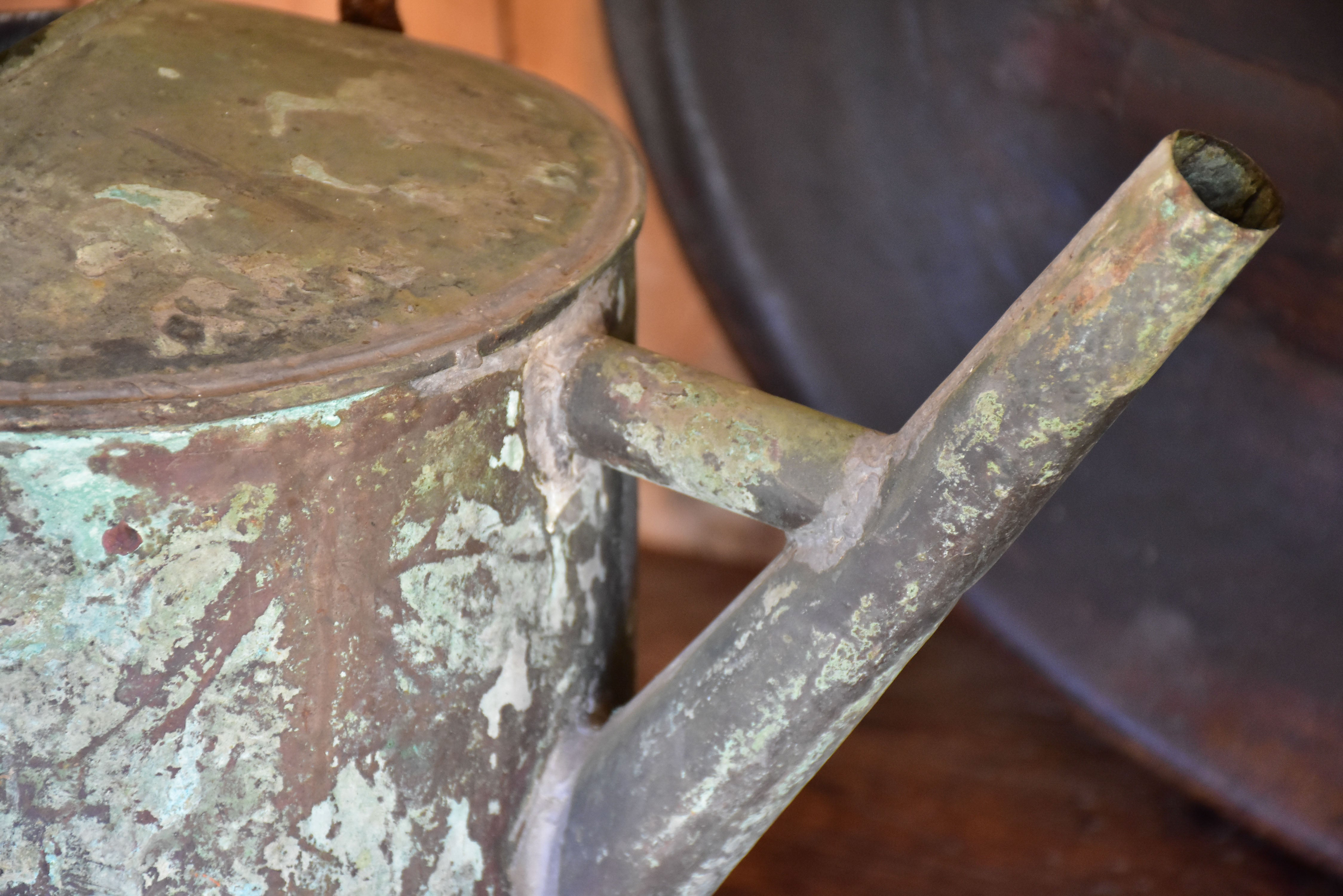 Antique French watering can with blue / green patina