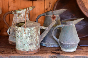 Collection of four antique French watering cans