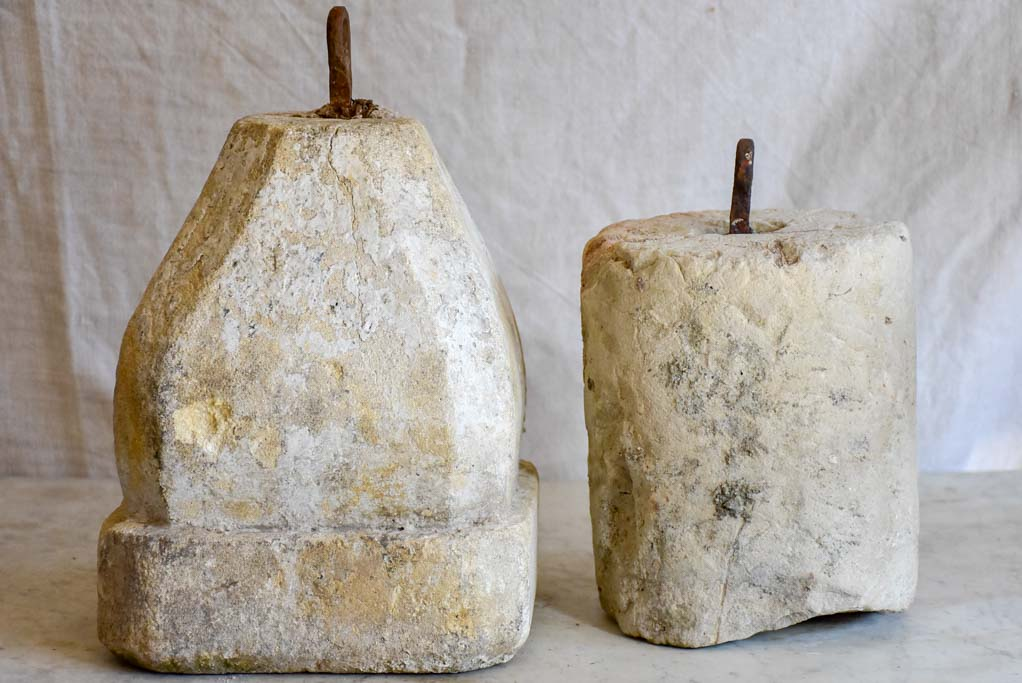 Two antique French stone counterweights