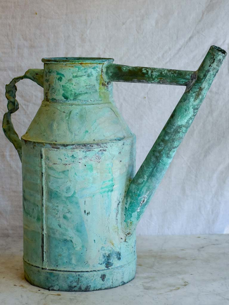 Antique French copper watering can with aqua blue patina