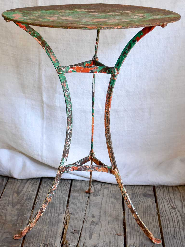 Rustic French garden table with weathered green and orange patina