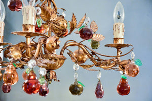 Vintage Italian chandelier with Murano glass fruits and a decorative gilded frame