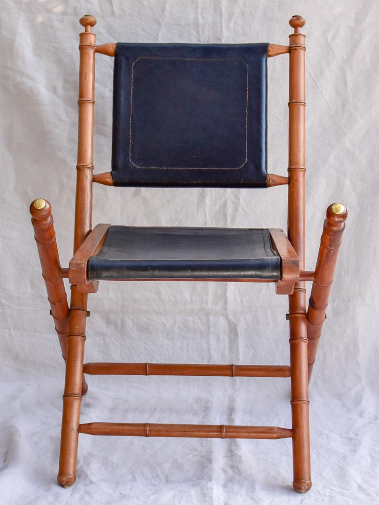 Four antique French colonial folding leather boat deck chairs