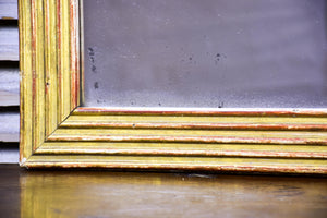 18th century Louis XVI giltwood mirror with reeded frame