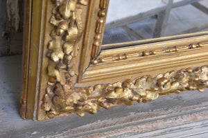 Large square gilded French mirror with sculptural oak leaf frame