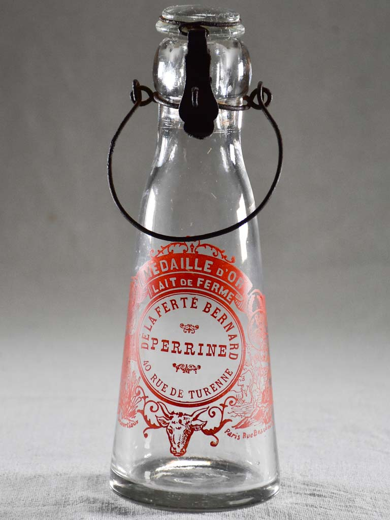 Antique French milk bottle with red transfer label 9¾""