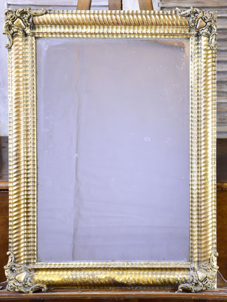 Antique French mirror with gold gadrooned frame