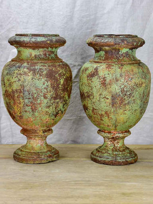Pair of 19th Century cast iron garden urns with timeworn green patina 16¼""