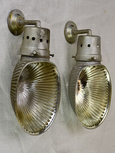 Pair of mid century holophane wall sconces from a boutique