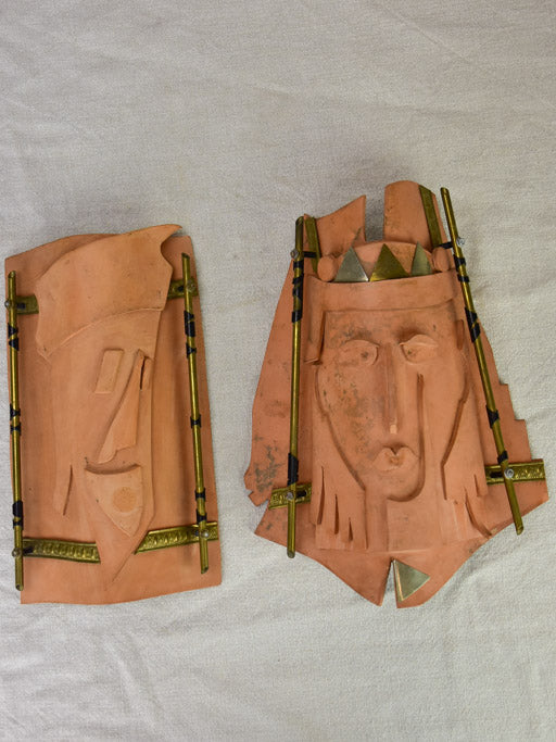 Pair of vintage handmade terracotta tile wall sconces with faces 11¾""