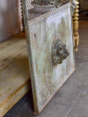 Antique French garden gate with lion's head