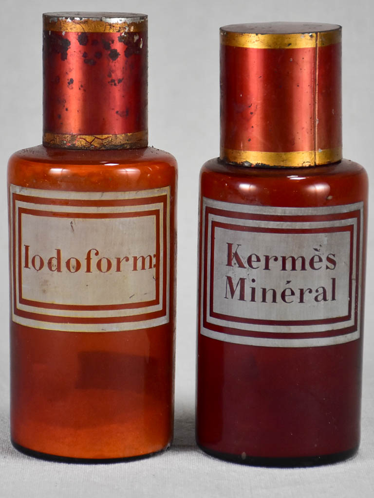 Two late nineteenth-century French apothecary jars with red tin lids 8¼""