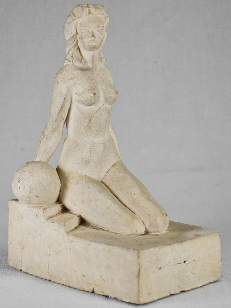 1940's plaster sculpture of a lady and a ball 12¼""
