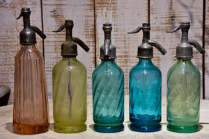 Collection of 10 antique seltzer bottles