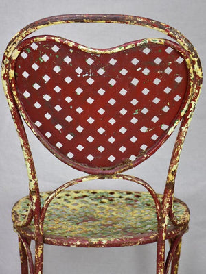 Early 20th Century French garden chair with original patina and heart back