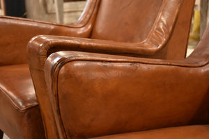 Pair of petite 1960's leather French armchairs